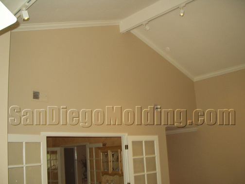 We install crown molding on any vaulted ceiling as high as can be